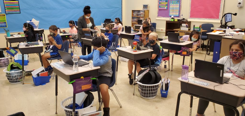 Using district Chromebooks for class lessons.